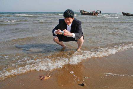 Chinese tourist and a creature of the sea. Beidaihe, China 2007
